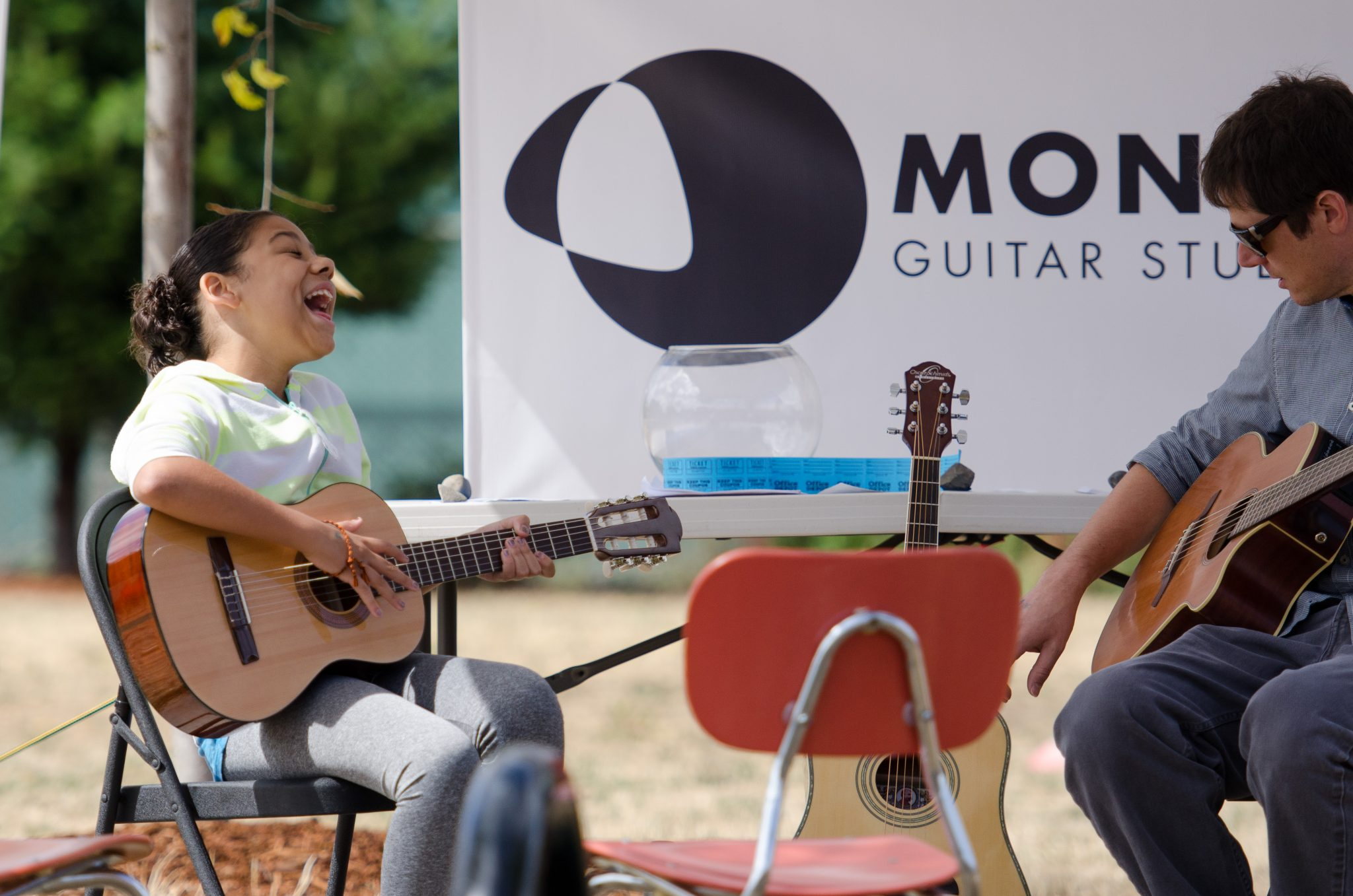 Montavilla Guitar Studio guitar booth outreach at local schools